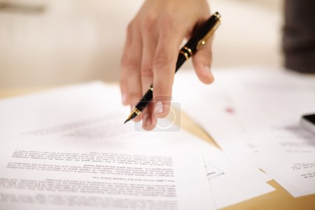 Photo for Background of business documents and a pen. - Royalty Free Image