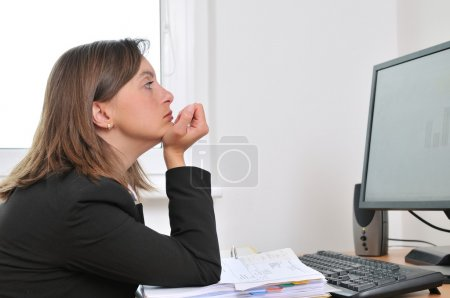 Photo for Tired and bored young business woman in depression sitting at computer on workplace - Royalty Free Image