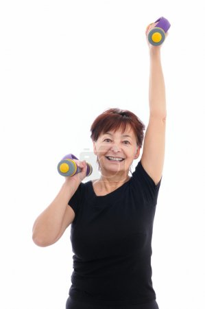 Senior woman with barbells