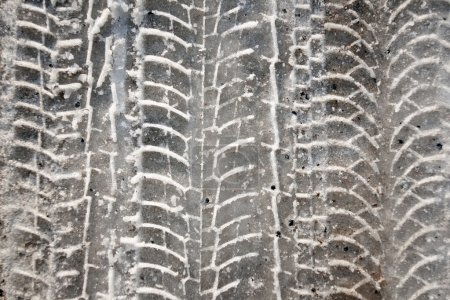 Photo for Close up of tire tracsks in wet snow - Royalty Free Image