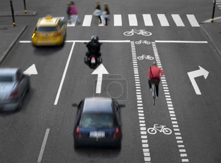 Photo for Blurred cars, bikes and pedestrians on busy street - Royalty Free Image