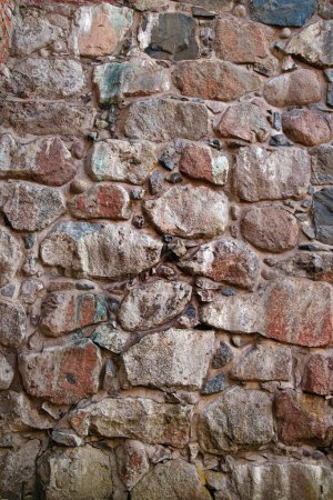 Photo for Ancient natural stone wall in various colors - Royalty Free Image