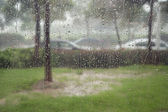 Glass window in rain storm