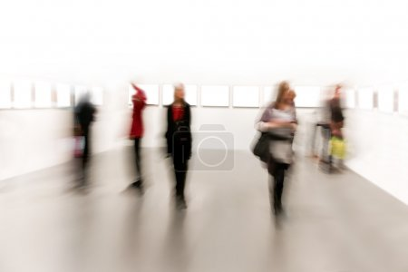 Photo for Watching paintings in a museum - Royalty Free Image