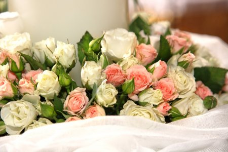 Photo for Close-up of flowers and a big candle on a greek wedding - Royalty Free Image