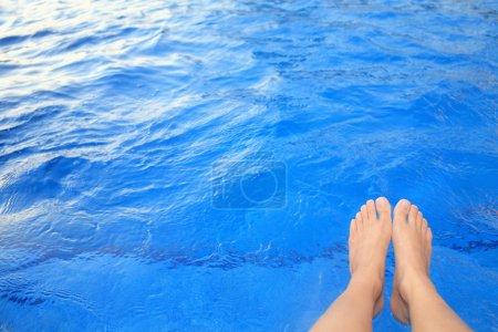 Feet beside the pool