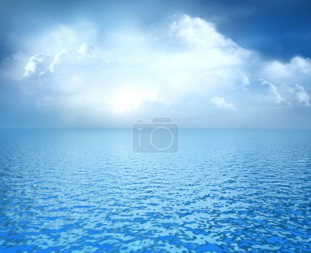 Blue ocean with white clouds on horizon
