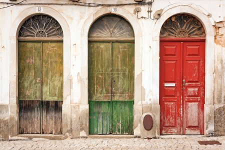 Photo for Facade of abandoned building with three doors - Royalty Free Image