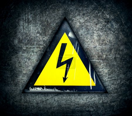 Symbol of high voltage on a steel background