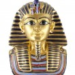 A gold statue of Tutankhamun isolated in white bac...