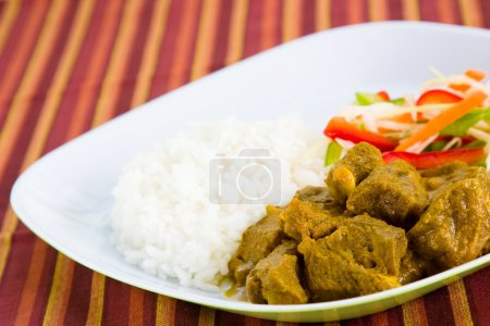 Goat Curry with Rice - Caribbean Style