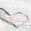 Fishing hooks on the Bible with focus on a very po...