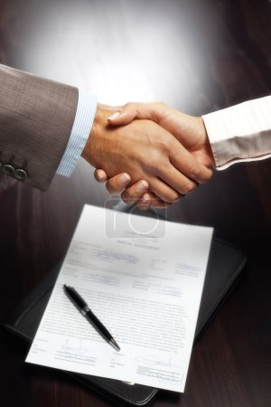 Handshake above signed contract