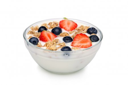 Bowl of yoghurt, with muesli and fruit