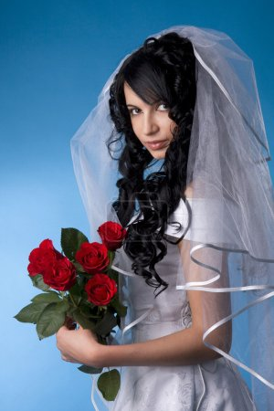 Brunette bride with red roses