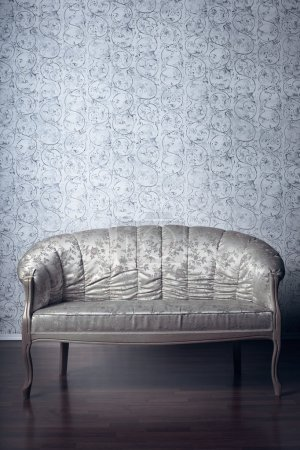 Glamorous sofa in the background of vintage wallpaper
