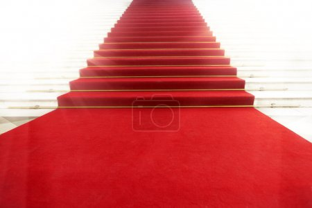 Photo for Image on the staircase with red carpet, illuminated by light - Royalty Free Image