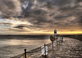 HDR Path to the Lighthouse with Cloudy Sky
