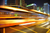 High speed and blurred bus light trails in downtown nightscape