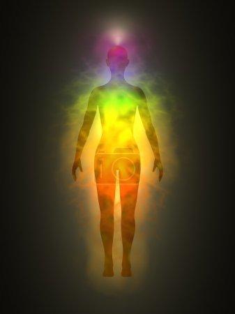 Foto de Ilustración de la silueta del cuerpo de energía humana (mujer) con aura y chakras. Tema de la Creación, energía sanadora, conexión entre el cuerpo y el alma . - Imagen libre de derechos