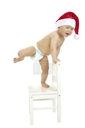 Little boy wearing Santa hat