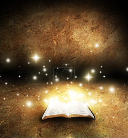 An open Bible with glowing lights and stars on an ...