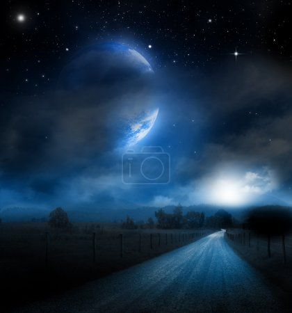 Photo for A large moon and star background over an old road in the countryside - Royalty Free Image