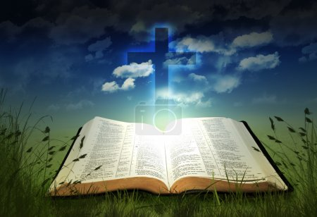 Glowing open Bible with cross...