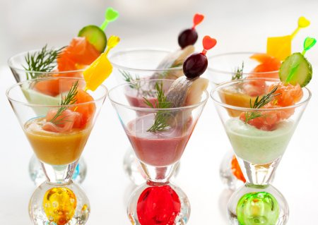 Photo for Salmon and herring appetizers in glasses with three different sauce(mustard,wasabi and cranberry sauce) - Royalty Free Image