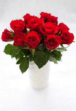 Photo for Red roses in vase on the white background - Royalty Free Image