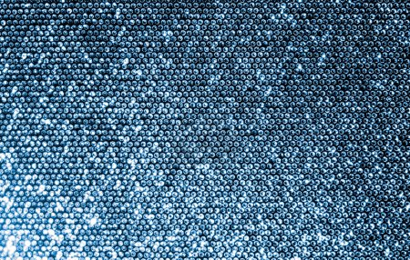 Photo for Silver fabric made of a grid of sparkling sequins. - Royalty Free Image