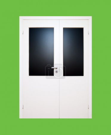White closed door isolated on green background (cl...