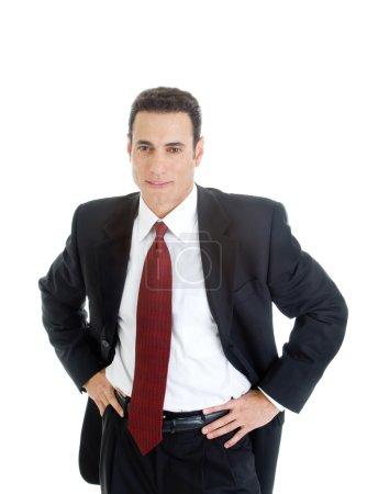 Photo pour Une homme d'affaires blanc confiant dans un costume, les mains sur les hanches. isolé sur fond blanc. - image libre de droit