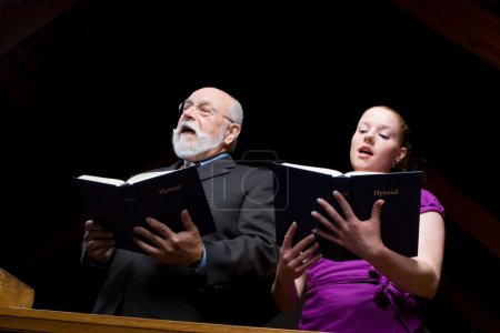 Older White Man Young Woman Singing Church Hymnals