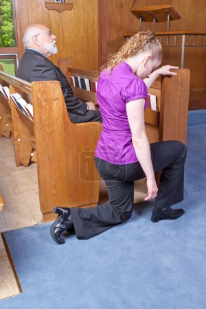 Young Caucasian Woman Kneeling End Church Pew, Senior Man Sittin