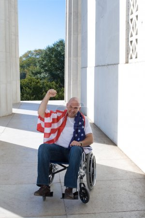 Man Wheelchair American Flag Raised