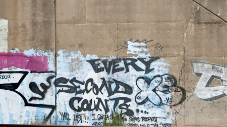 Every Second Counts Graffiti on Cement Wall