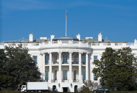 Photo for White House with white truck making a delivery parked in front. - Royalty Free Image