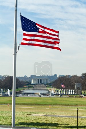 Photo for National Mall in Winter with World War II and Lincoln Memorials in the background. Flag is at half mast. - Royalty Free Image
