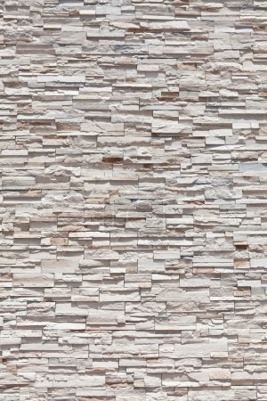 Photo pour Mur de pierre verticale plein cadre grès fabriqué à partir de nombreux blocs individuels. - image libre de droit