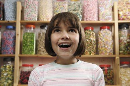 Girl in sweet shop