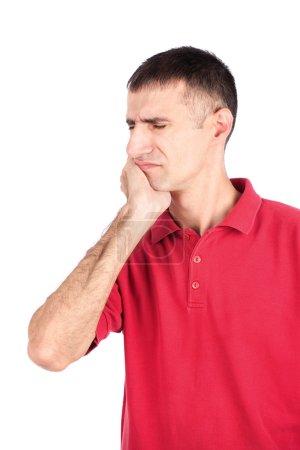 Photo pour Homme dans une expression douloureuse à cause de maux de dents, isolat sur fond blanc - image libre de droit