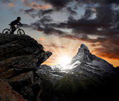 Silhouette biker in the Swiss Alps