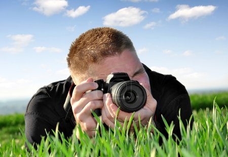 Photo pour Photographe avec appareil photo reflex - image libre de droit