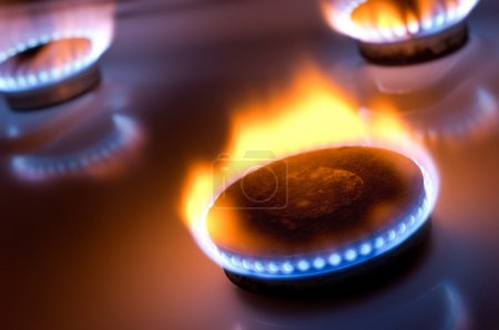 Gas burner with yellow flame in the kitchen oven...