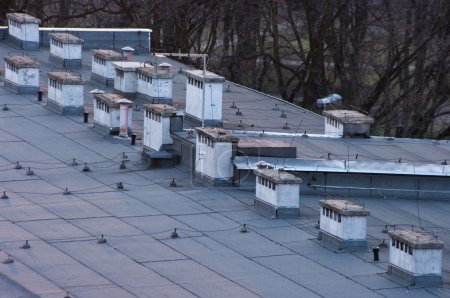 Flat roof with many chimneys