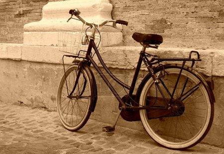 Old bicycle leaning on a wall